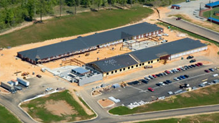 Projects: Aerial view of elementary school buildings under construction