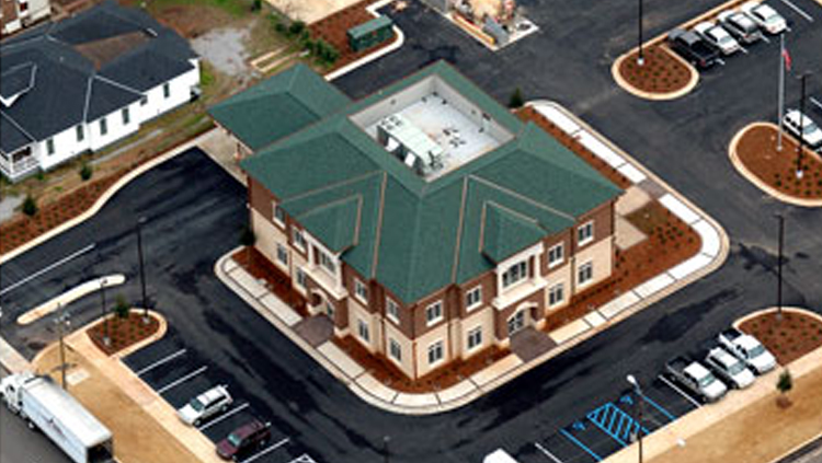 Projects: Aerial view of square bank building with slanted green roof