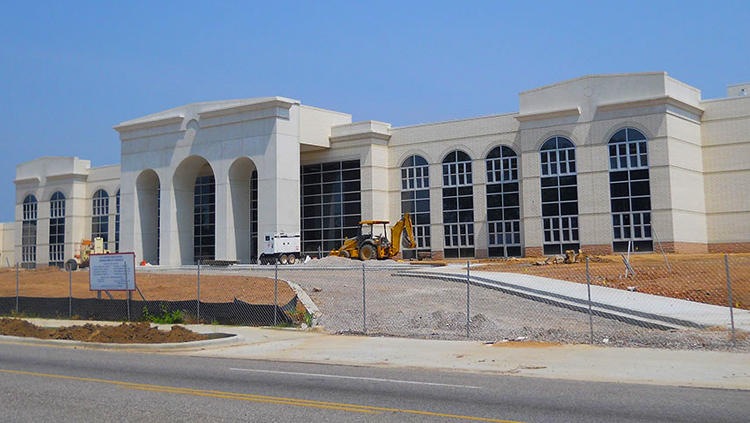 Projects: View of front of high school building under construction
