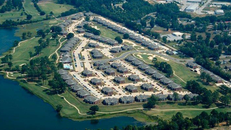 Projects: Aerial photo of large apartment complex near water
