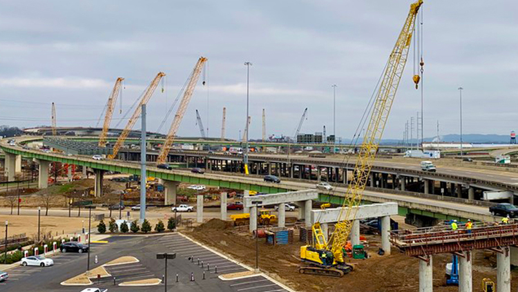 Projects: Multiple cranes at interstate highway construction site.
