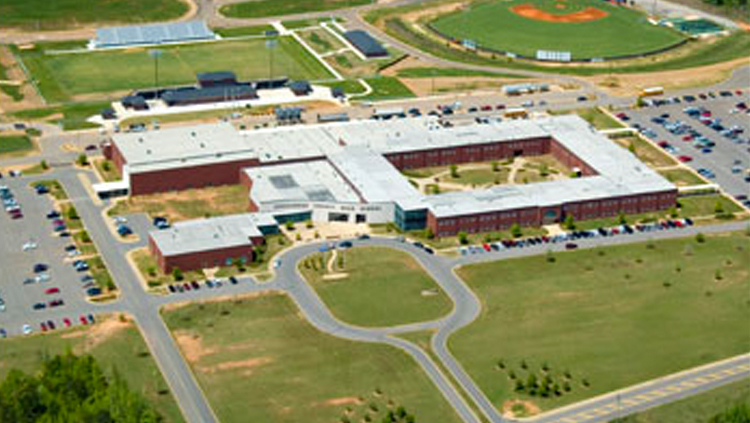 Projects: Aerial view of high school campus with large oval driveway