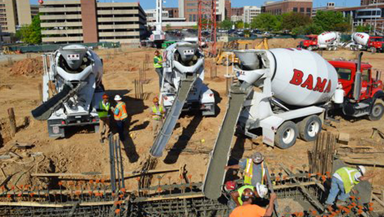 Projects: Three concrete trucks offloading